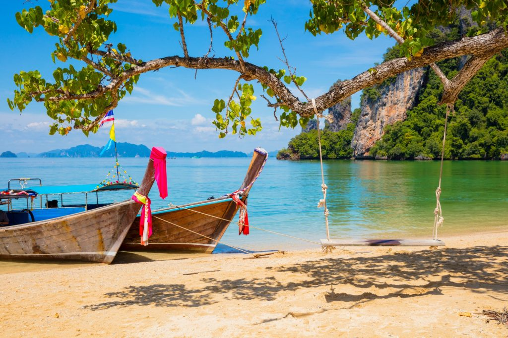 Longtail Boats Moored On Beach in Thailand